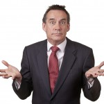 Handsome Middle Age Business Man in Suit with Surprised Expression Isolated