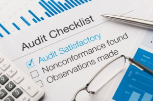 Audit checklist on a desk, with tick against audit satisfactory